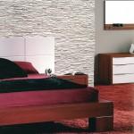 Dormitorio con piedra decorativa blanca